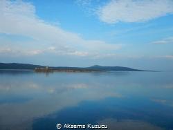 An island & coast view of Cunda island, Ayvalik, Turkey by Aksems Kuzucu