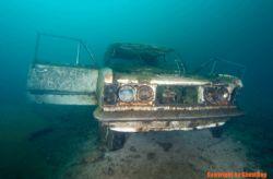 "Poland, small lake in Cracow ZAKRZOWEK ""Polish Fiat 125p"" by Olgierd Graca"