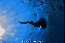 Diver sun&torch by Yildirim Gencoglu