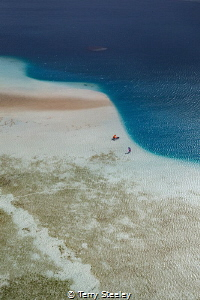 Kite surfing the sandbar. by Terry Steeley