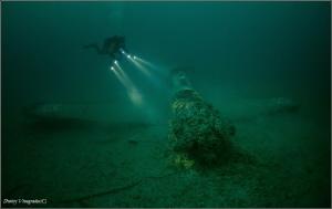 Stars Curtiss P-40 Kittyhawk. 50 meters deep. by Dmitry Vinogradov