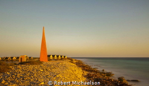Red slave huts in Bonaire, maintained as a reminder to th... by Robert Michaelson