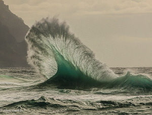Waves collide on the Napali Coast. Kauai, Hawaii by Tony Cherbas