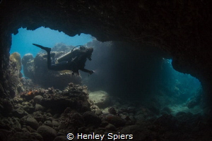 Jade enters the famous Lover's Tunnel in Saint Lucia by Henley Spiers