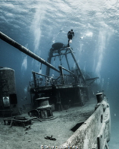 'On One Breath' - A freediver ascends from the wreck of t... by Tanya Houppermans