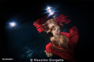 Underwater models in Italy - woman in red by Massimo Giorgetta