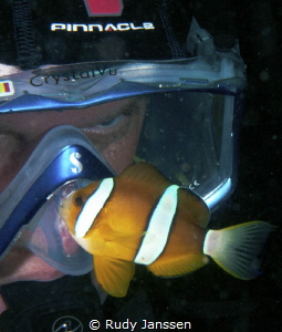 Diver with Clownfish by Rudy Janssen
