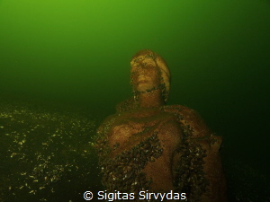 The virgin of the deeps. Statue in the lake Plateliai. by Sigitas Sirvydas