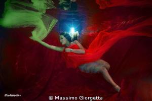 fashion in swimmingpool by Massimo Giorgetta