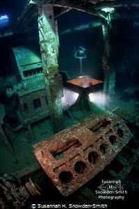 A diver explores the engine room of the ex-USS Kittiwake.... by Susannah H. Snowden-Smith