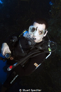 A very focused diver slowly ascending from the depths.  H... by Stuart Spechler
