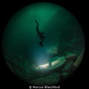 Diver scoots towards the blinding light by Marcus Blatchford