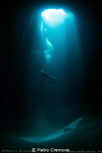 Cave and diver by Pietro Cremone