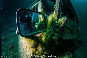 Diver in the mirror by Andrius Stanevicius