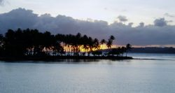 Sunrise at Truk Lagoon from the deck of the Odessy Late D... by Bill Strode
