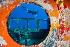 """Porthole Frame"" A diver is framed through a porthole on... by Susannah H. Snowden-Smith"