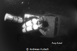 Diver along the R4 Wreck by Andreas Kutsch