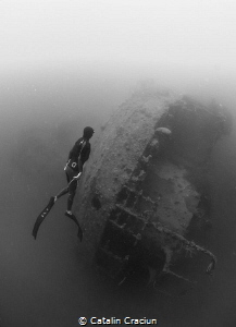 Freediver at Morazan Maru , Japanese WWII ship wreck in C... by Catalin Craciun
