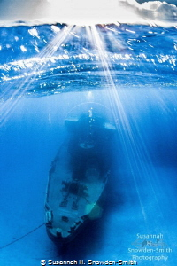 The ex-USS Kittiwake is seen in an over-under photograph ... by Susannah H. Snowden-Smith