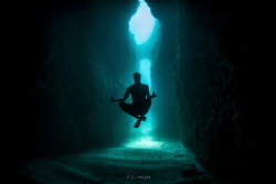Underwater meditation on the way to secret bat cave by Guillaume Holzer