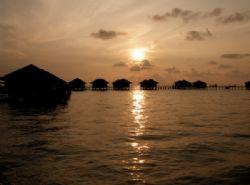 Sunrise at Sipadan Water Village, Mabul Island by Alex Lim