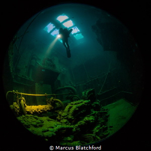 Diver inside the engine room of Kensho Maru by Marcus Blatchford