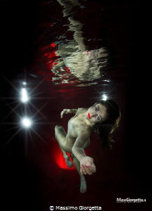 naked in swimmpool the mermaid by Massimo Giorgetta