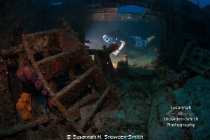 Look closely: a diver is lit by a remote slave strobe as ... by Susannah H. Snowden-Smith