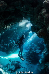 Diver In Caves by John Parker