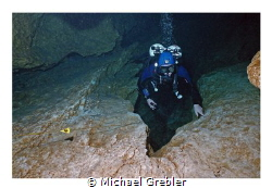 """My dive buddy pauses above the """"chimney"""" as we work our w... by Michael Grebler"""