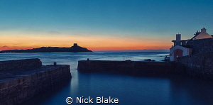 Sunrise over Colliemore Harbour, Dublin, Ireland by Nick Blake
