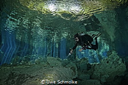 Cave diving by Uwe Schmolke