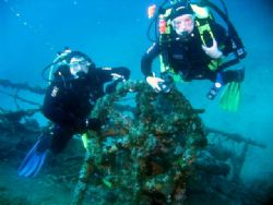 Divers on wheel of the wreck of the Teti, taken with Cano... by Michael Moore