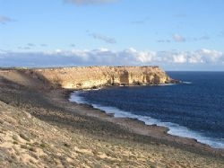 """""""The Caves"""" This dive site situated about 20km North of C... by Damien Preston"""