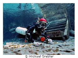Portrait of a side-mount cave diver at Ginnie Cavern, Flo... by Michael Grebler