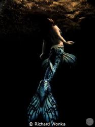 Kimberley Chai introduces a dark note to mermaiding. She ... by Richard Wonka