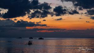 Fishermen near Manado, Sulawesi. by Filip Staes