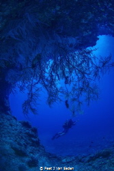Into the deep blue caves of Situ island by Peet J Van Eeden