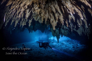 Diver in Dream Gates, Playa del Carmen Mexico by Alejandro Topete