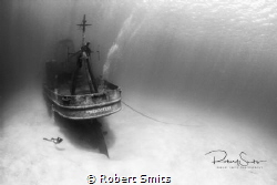 A diver checking out the wreck of the USS Kittiwake. by Robert Smits