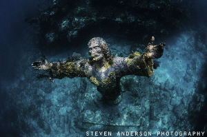 The Christ Statue located at John Pennekamp Park. The sta... by Steven Anderson