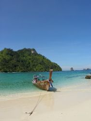 Long tail boat on an island in Phang nga Bay in Thailand by Gordana Zdjelar