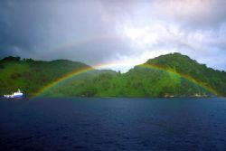 Cocos Island, after one of the frequent rain showers (Nik... by Andrew Dawson