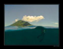 Manado Tua with diver by Marc Kuiper