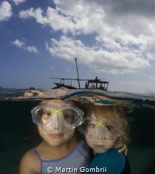 My daughter and her best friend exploring the wonders und... by Martin Gombrii