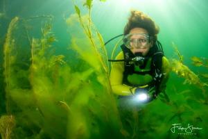 Between the algae, the pond of Ekeren, Belgium, model: Ma... by Filip Staes