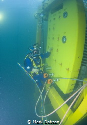Diver running a testing schedule on an ROV panel which co... by Mark Dobson