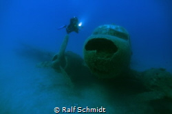 Old airplane in the bay of Kas by Ralf Schmidt