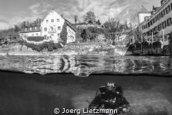 A great divespot during winter. A wild man above and unde... by Joerg Lietzmann