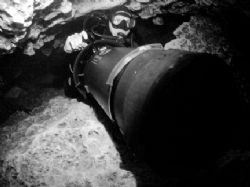 Diver scootering through Jackson blue cave in Marianna FL. by Becky Kagan